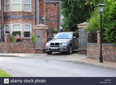 buying house for parents to live in a car leaving coleen rooney s parents house it is rumoured she stock photo royalty