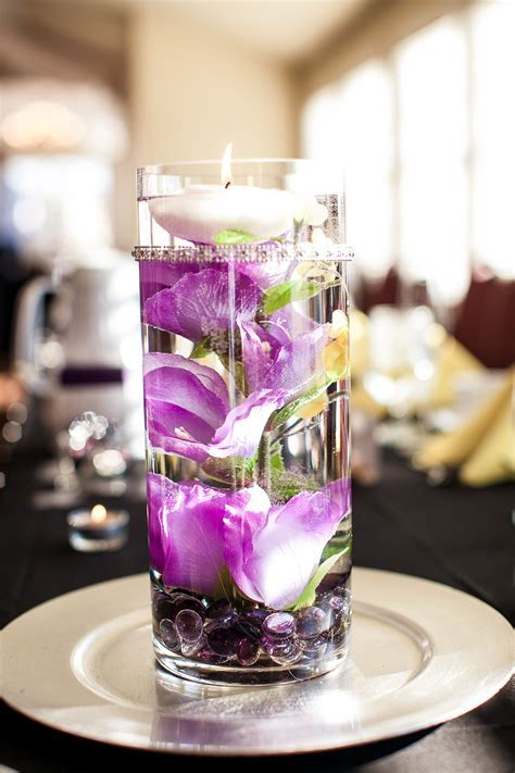 Centerpieces   cut up fake flowers floating in water with