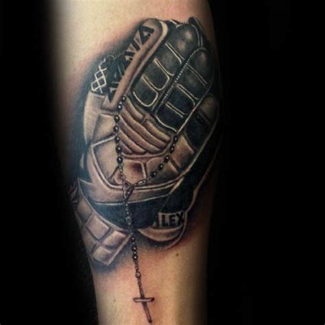 small soccer tattoos guys soccer goalie gloves on forearm tattoos