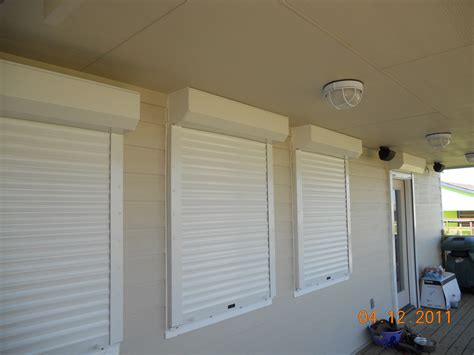 storm awnings beware of cheap hurricane shutters why cheap motorized shutters are the most expensive