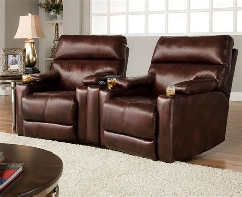 theater seating with 2 lay flat recliners and cup