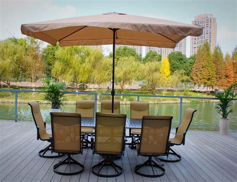 pebble living patio dining set with umbrella sets on