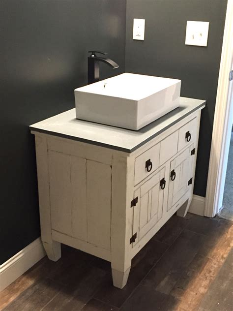 white farmhouse bathroom vanity featuring andrew