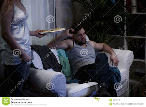 lazy guy on couch lazy man sitting on the sofa stock photo image 56043410