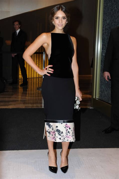 Hotel Armani jessica alba showing off her ass in tight black skirt at