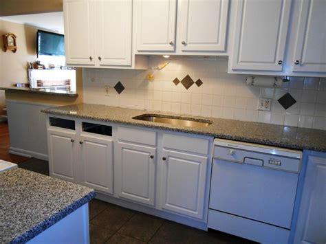 New Caledonia Granite White Cabinets by White Kitchen Cabinets With New Caledonia Granite Quicua