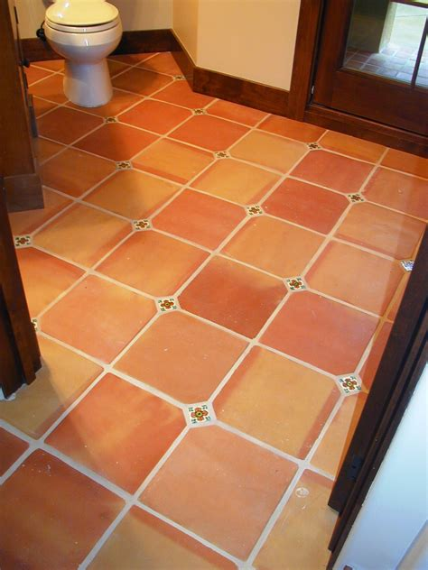 spanish for floor 12x12 traditional terra cotta tiles with a 2x2 insert cut