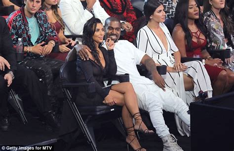 jonathan pryce kanye west kim kardashian and kanye west seem engrossed in their