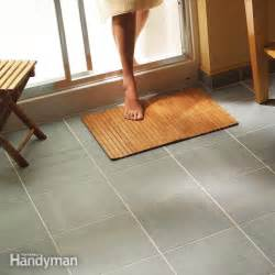 Installing Ceramic Floor Tile Install A Ceramic Tile Floor In The Bathroom The Family Handyman