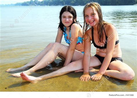 teen candid family beach two girls in water stock photo i1411066 at featurepics