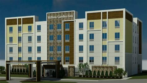 kmg hotels plans pair of hiltons on vacant office site