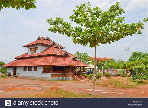 buy a house in kerala traditional architecture of a tiled roof house in kerala using stock photo royalty
