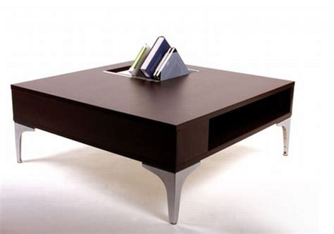 a coffee table with the storage area for holding books and