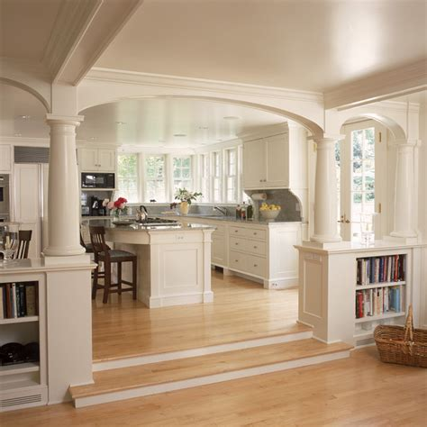houzz cim white kitchen and breakfast room with fireplace and arches