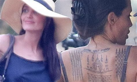 tattoo angelina jolie betekenis angelina jolie debuts new tattoos and directs khmer rouge