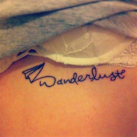 tattoo meaning wanderlust quot wanderlust quot tattooed under her left breast tatoos