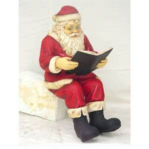 santa claus sitting reading book christmas themed figures
