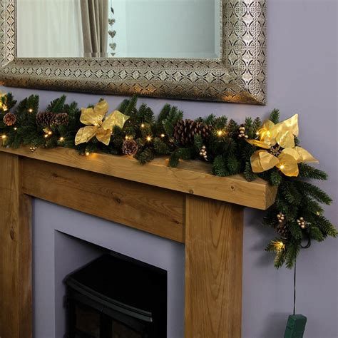 1 8m outdoor green battery pre lit garland with gold