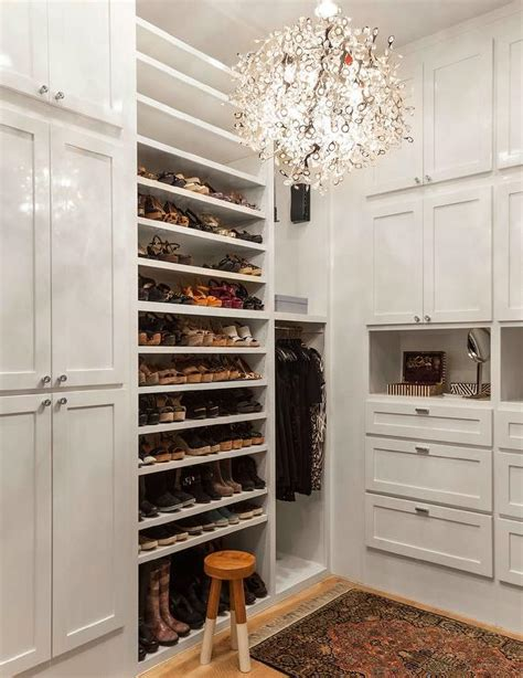 Shoe Closet With Doors Walk In Closet With Paneled Bi Fold Wardrobe Closet Doors Transitional Walk In Closet With Tilted Shoe Shelves Transitional Closet