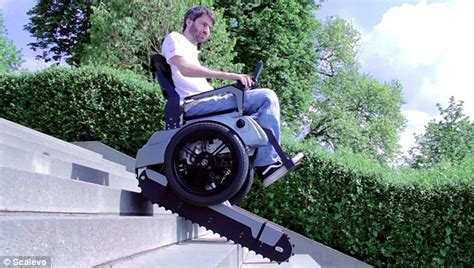 chair that goes up the stairs scavelo wheelchair uses rubber tank tracks to climb