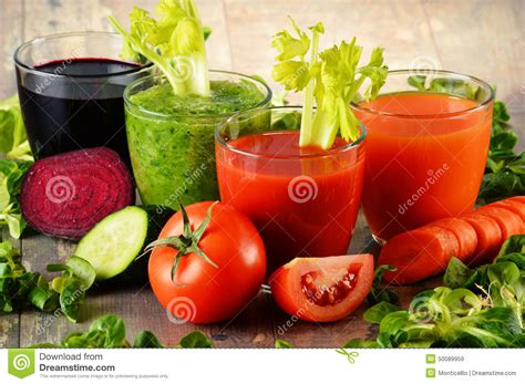 Vegetable Juice Detox Diet by Glasses With Fresh Organic Vegetable Juices On Wooden Table