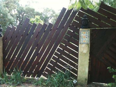 angled wood slat fence denis king landscape designs