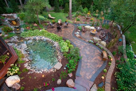 Paver Patio With Natural Rock Pond and Cozy Seating Areas