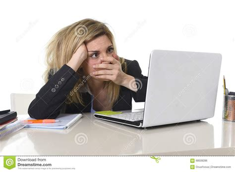young beautiful business woman suffering stress working at