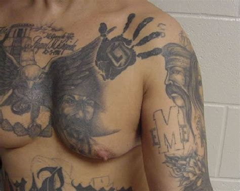 gang related tattoos mexican mafia la eme tattoos on the chest and arm