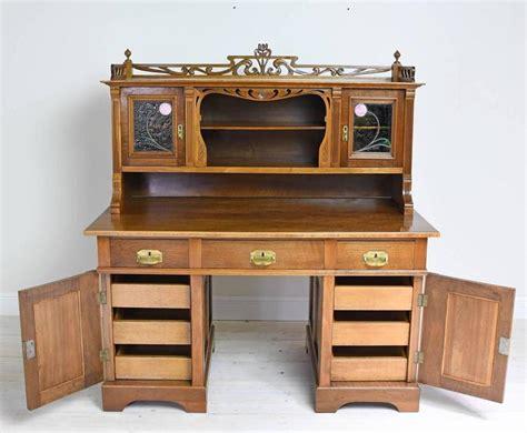 nouveau walnut pedestal desk with cabinet and