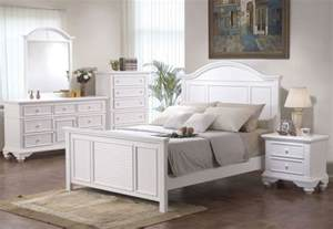 decorate the room with white colored bedroom sets