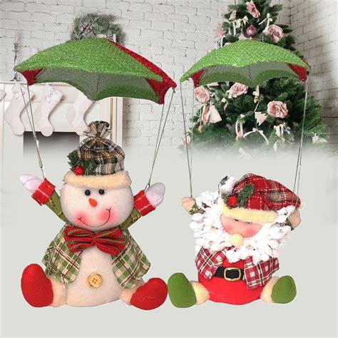 santa claus snowman in parachute tree