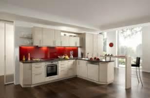 Modern planked wood cream kitchen with coloured glass splashback