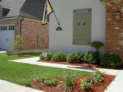 small front yard landscaping traditional window side wall l on brick wall right