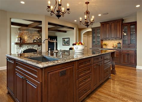 kitchens with an island allow room for dining with a large kitchen islands