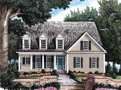 gray house dark gray shutters muted aqua blue door