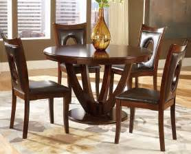 Solid wood round dining table amp keyhole parson chairs