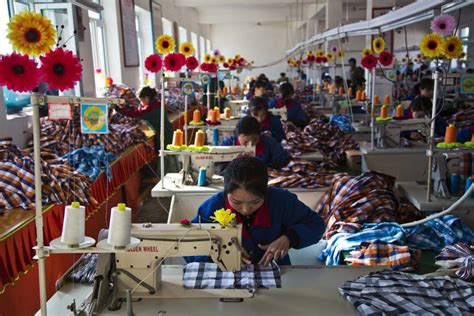 amazon co jp making michael inside the career hemmed in seamstresses work at the sonbong textile factory saturday inside north korea s rason