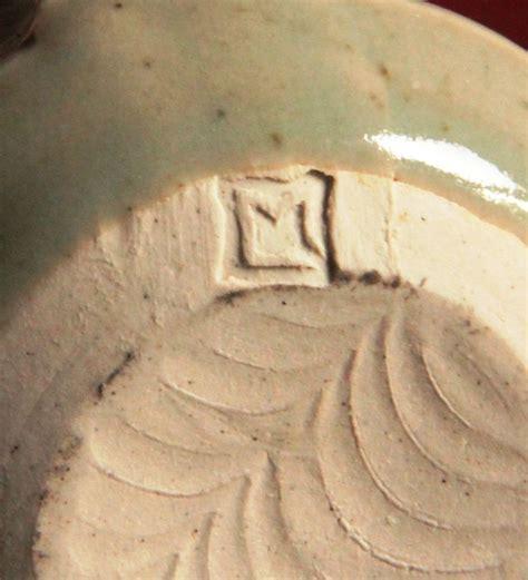 M Porcelain pair of studio pottery demitasse stoneware mugs merryn
