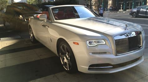 luxury cars rolls royce rolls royce dawn pearl white red convertible exotic