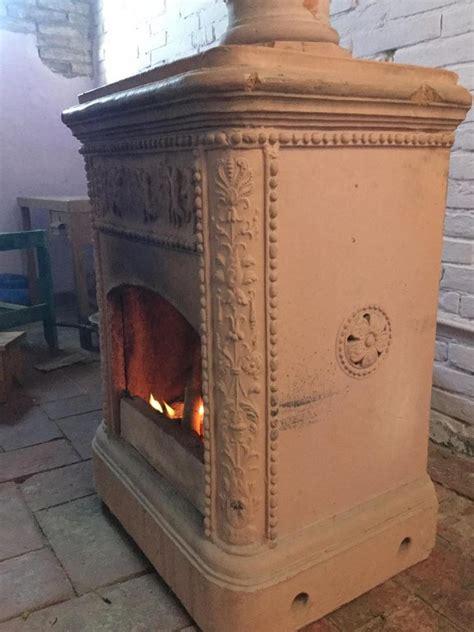 riscaldamento vasi terracotta stufe a legna in steatite o in terracotta muratore