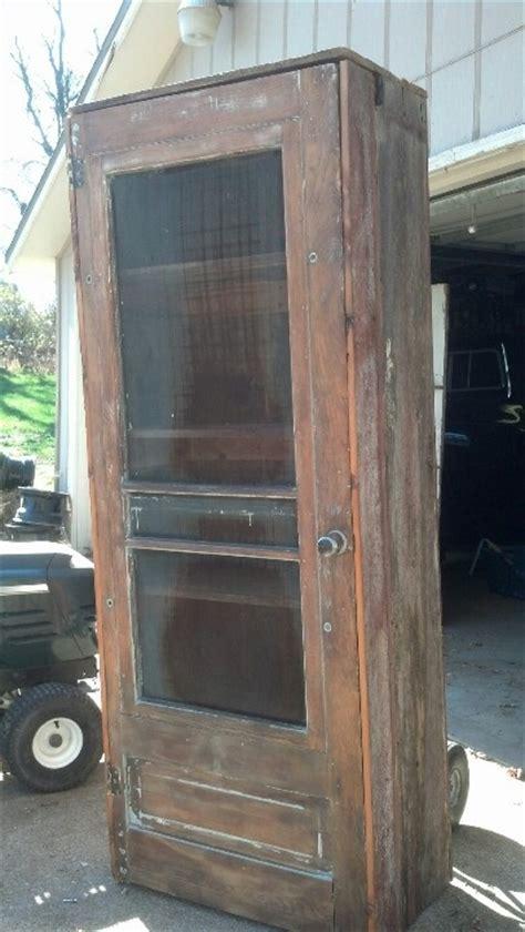 barn board cabinet doors home improvement pinterest barn board book cabinet with old screen door front just