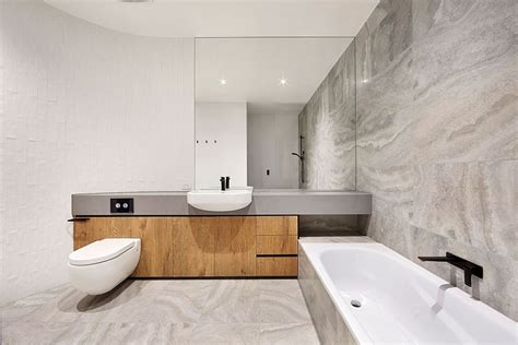 minimal bathroom an entrance to behold 1970s home acquires a modern