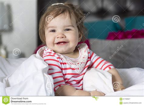 one year old bed one year old girl in bed stock photo image 61769927
