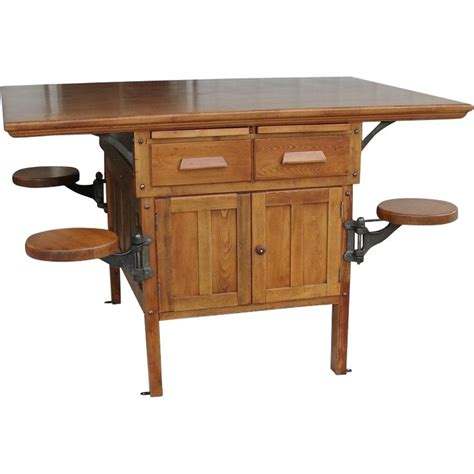 table with swing out stools 1920 s school industrial arts table or counter with 4