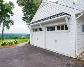 garage overhang home design ideas pictures remodel and decor this striking three car has attractive hip roof