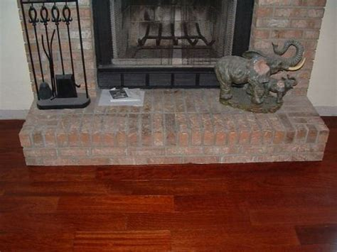 installing laminate flooring around stone fireplace