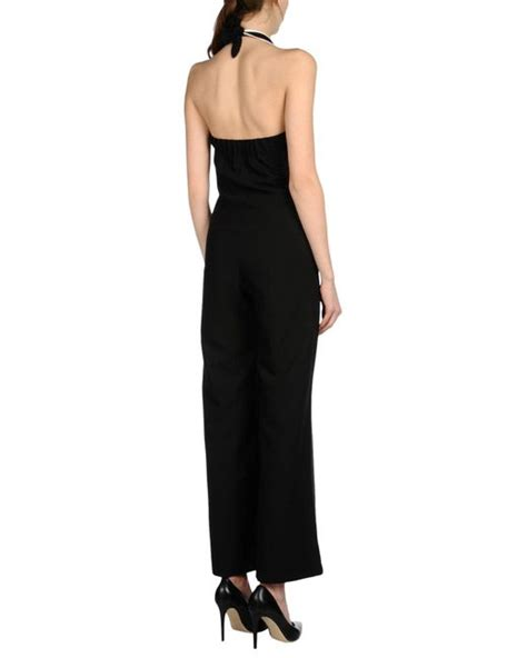 mantoux gaia paneled sheer lace tulle jumpsuit in mantoux jumpsuit in black lyst