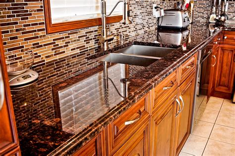 Granite Countertops Pros And Cons by Brown Granite Countertops Pictures Cost Pros And Cons