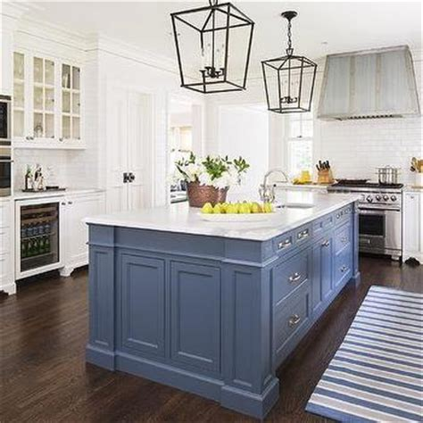 blue kitchen island over cabinet flatscreen tv niche transitional kitchen